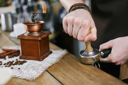 Barista Making Coffee at Bar Stock Photo