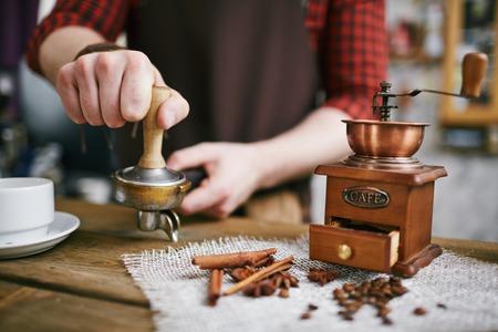 Old-Fashioned barista Making Cinnamon Coffee Stock Photo