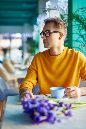 blind date: Romantic Guy Waiting for Date in Cafe