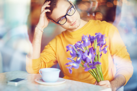 blind date: Pensive Man with Flowers Waiting for Date