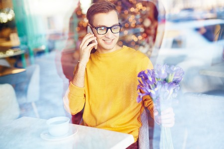 blind date: Young Man on Date in Cafe Stock Photo