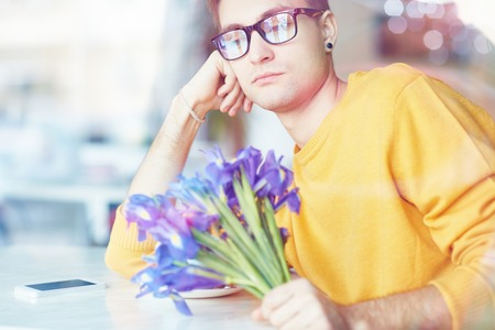 Young Man with Flowers Waiting for Date