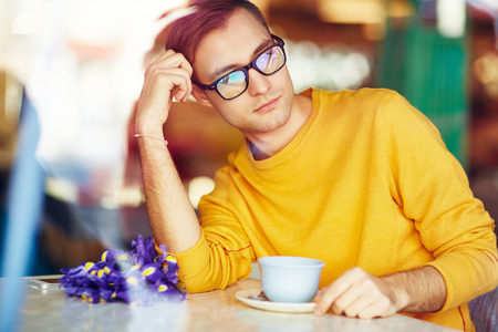 blind date: Handsome Young Man with Flowers in Cafe