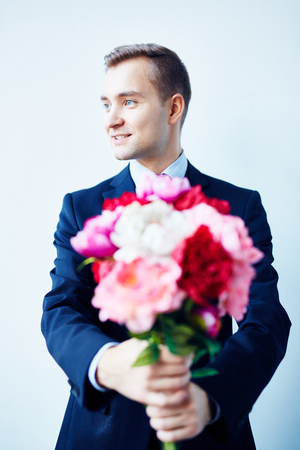 Handsome Young Gentleman with Flowers Bouquet Stock Photo - 79862166