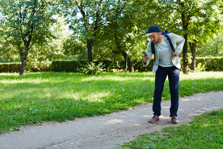 Walking in Park with Smartphone