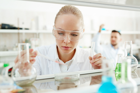 Woman Scientist Performing Experiment in Laboratory