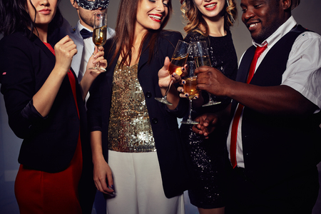 Toasting with Champagne Flutes photo