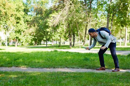 Bearded Gamer in Public Park