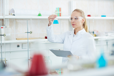 Serious Female Researcher in Laboratory
