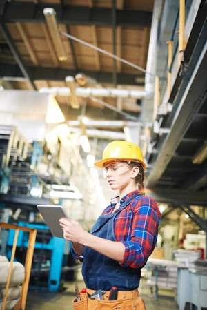 Confident Female Technician with Digital Tablet Stock Photo