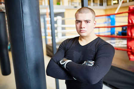 punched out: Portrait of  Determined Young Fighter