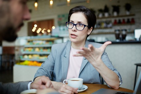 persuading: Modern Businesswoman at Work Meeting in Cafe