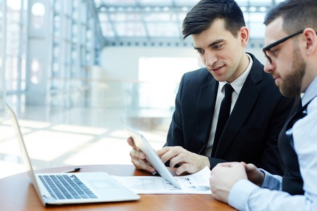 Modern Professionals Discussing Work in Planning Meeting Stock Photo