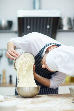 Baker at work Фото со стока