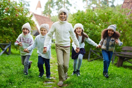 Happy Children Running Outdoors Stok Fotoğraf - 81643341