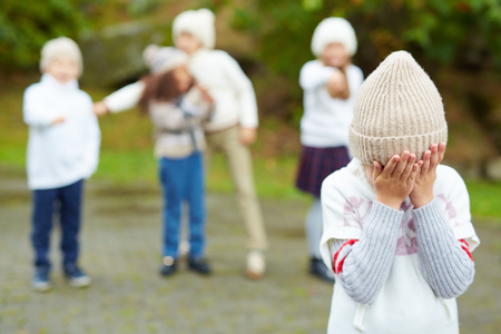 Cruel Children on Playground Standard-Bild