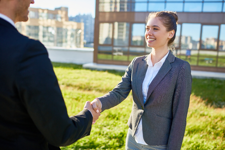 Greeting handshake Stock Photo