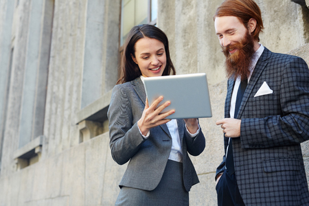 Managers with touchpad Stock Photo