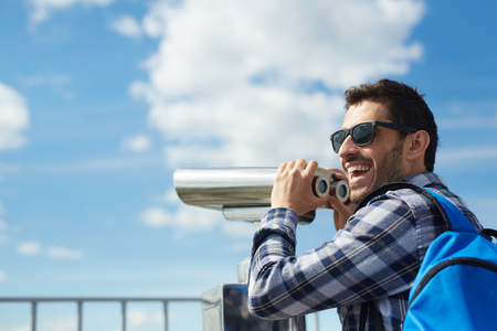 Cheerful Tourist on Rooftop Viewing Platform