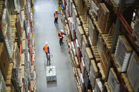 Movers and Loaders Working in Warehouse Stock Photo