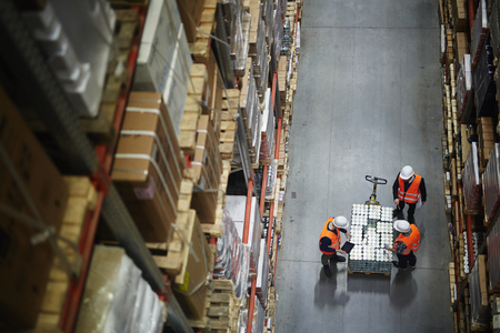 Workers Counting New Shipment in Warehouse