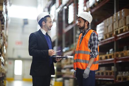 Supervisor Instructing Warehouse Worker
