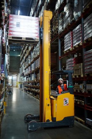 Warehouse loader Using Forklift Truck Stock Photo