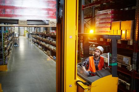 loader: Warehouse Loader Moving Goods