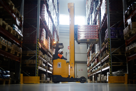 Warehouse Loader Using Forklift Truck Stock fotó - 82721554