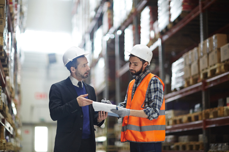 Warehouse Supervisor Talking with Order Builder