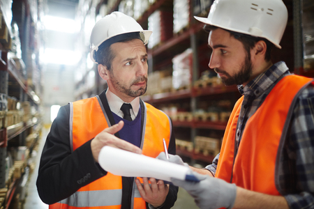 Two Warehouse Workers Reviewing Goods