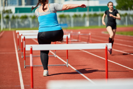 Overcoming hurdles Stock Photo