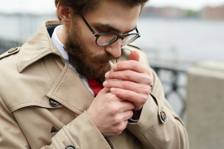 Young bearded smoker Stock Photo