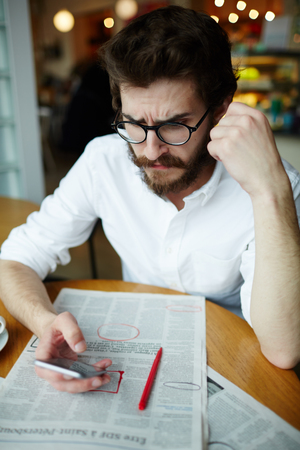 Man using phone to contact friend