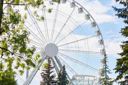 Background image of tall shiny Ferris wheel in modern amusement park