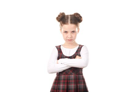 흰색 배경에 대해 십자가 무장 한 학교 유니폼을 입고 기분을 상하게 한 소녀의 초상 스톡 콘텐츠