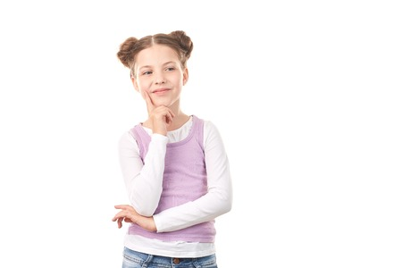 Portrait of beautiful little girl with hair buns against white background