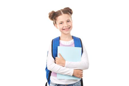 白い背景に、ポーズのバックパックと小学生