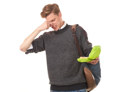 Portrait of high school student holding lucnhbox and expressing his emotions Stock Photo