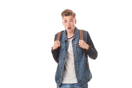 Portrait of schoolboy expressing emotions against white background Stock Photo