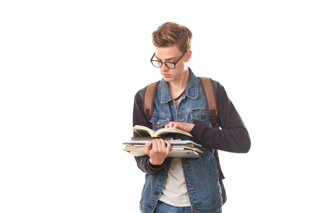 Portrait of college nerd in eyeglasses with stack of books