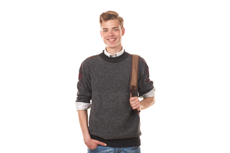 Studio portrait of handsome college boy in casual clothing with backpack Stock Photo