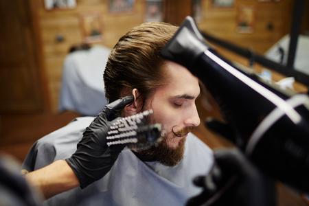barbershop: Man grooming hair at barbershop
