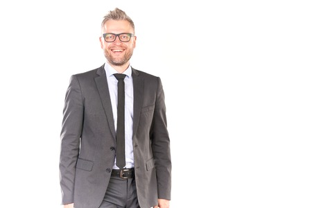 Portrait of confident businessman wearing suit and eyeglasses posing against white background 版權商用圖片
