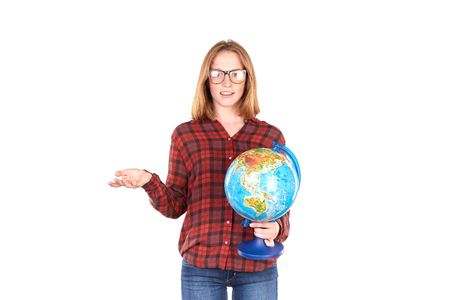 Studio portrait of female college student posing with globe isolated on white