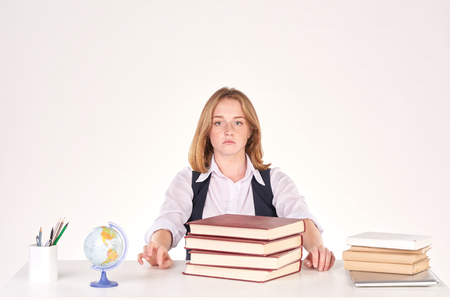 Portrait of red-haired female student studying at desk
