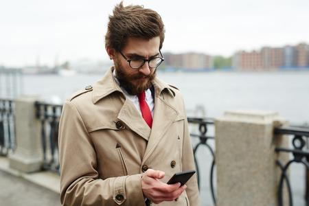 Businessman by riverside Stock Photo