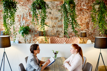 Conducting Interview at Fashionable Restaurant