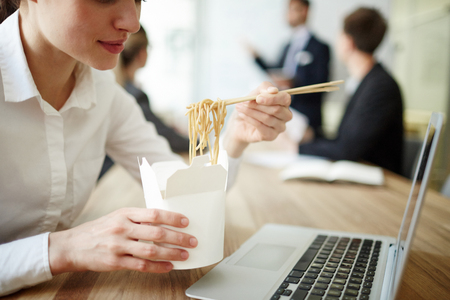 Eating at work Banco de Imagens