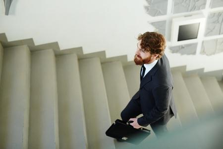 Climbing corporate ladder Stock Photo